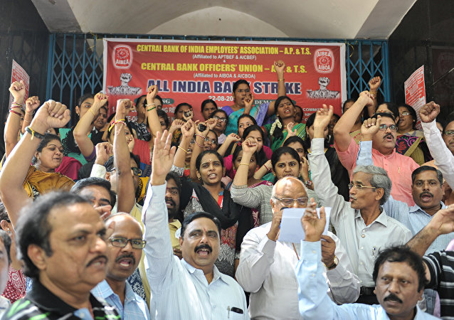 Indian bank employees representing the All India Bank employees Association (AIBEA) protest during a strike in Hyderabad