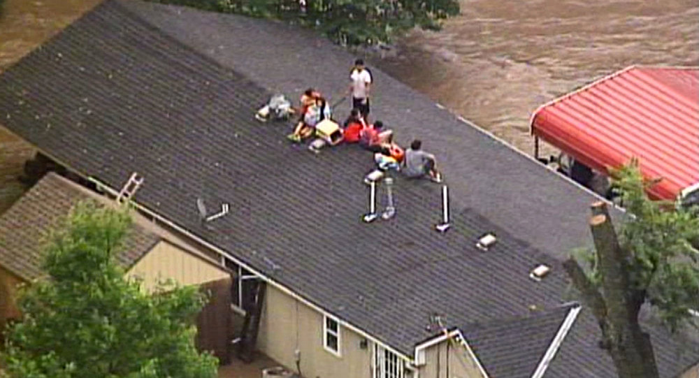 Voluntary evacuations after historic flooding hits Kansas City again