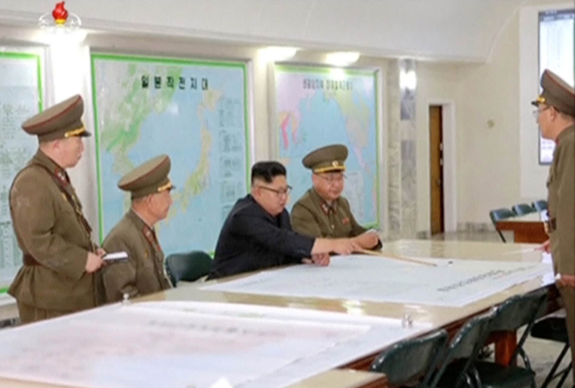 North Korean leader Kim Jong Un reviews the plan for landing missiles near the U.S. territory of Guam