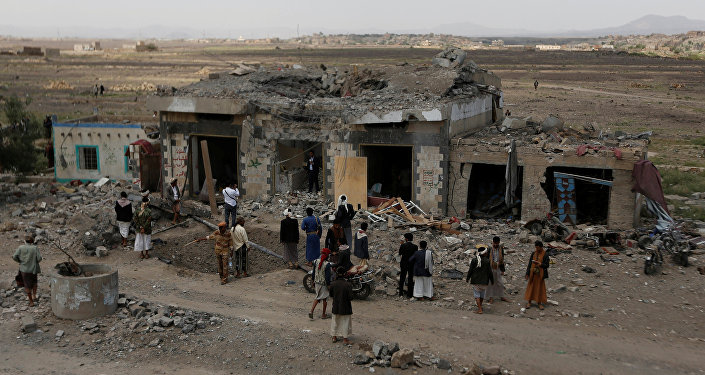 People gather at the site of Saudi-led air strikes in Arhab area, around 20 kilometres (13 miles) north of Sanaa, Yemen August 23, 2017
