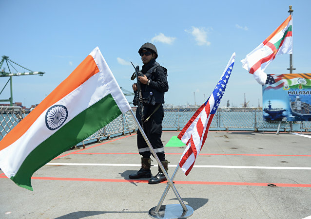 An Indian Navy sailor stands guard on the deck of the INS Shivalik during the inauguration of joint naval exercises with the United States and Japan in Chennai on July 10, 2017