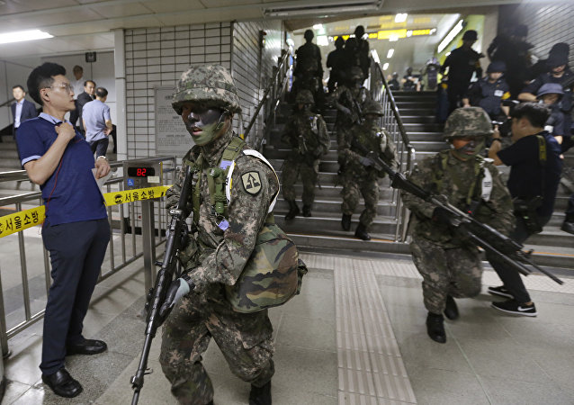 South Korean army soldiers conduct an anti-terror drill as part of Ulchi Freedom Guardian exercise inside a subway station in Seoul, South Korea, Tuesday, Aug. 22, 2017