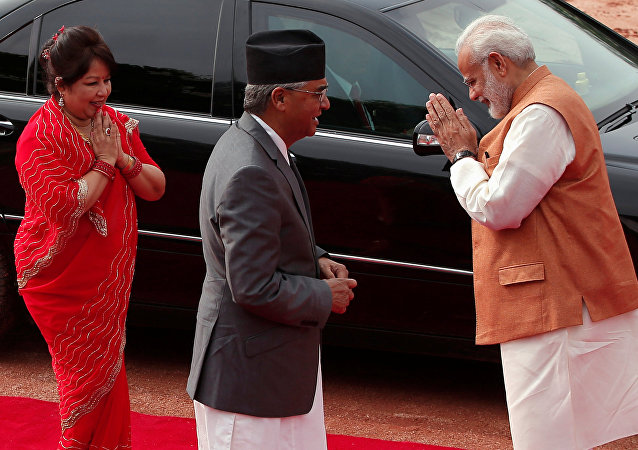 India's Prime Minister Narendra Modi (R) greets Arzu Rana Deuba (L) wife of Nepalese Prime Minister Sher Bahadur Deuba during Deuba's ceremonial reception at the forecourt of India's Rashtrapati Bhavan presidential palace in New Delhi, India, August 24, 2017