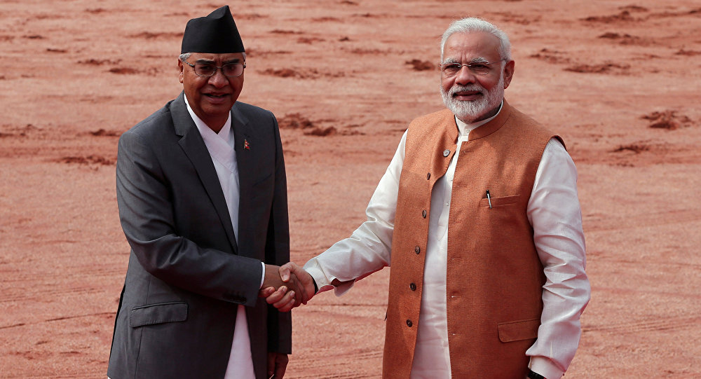 Nepalese Prime Minister Sher Bahadur Deuba shakes hands with his Indian counterpart Narendra Modi (R) during his ceremonial reception at the forecourt of India's Rashtrapati Bhavan presidential palace in New Delhi, India, August 24, 2017