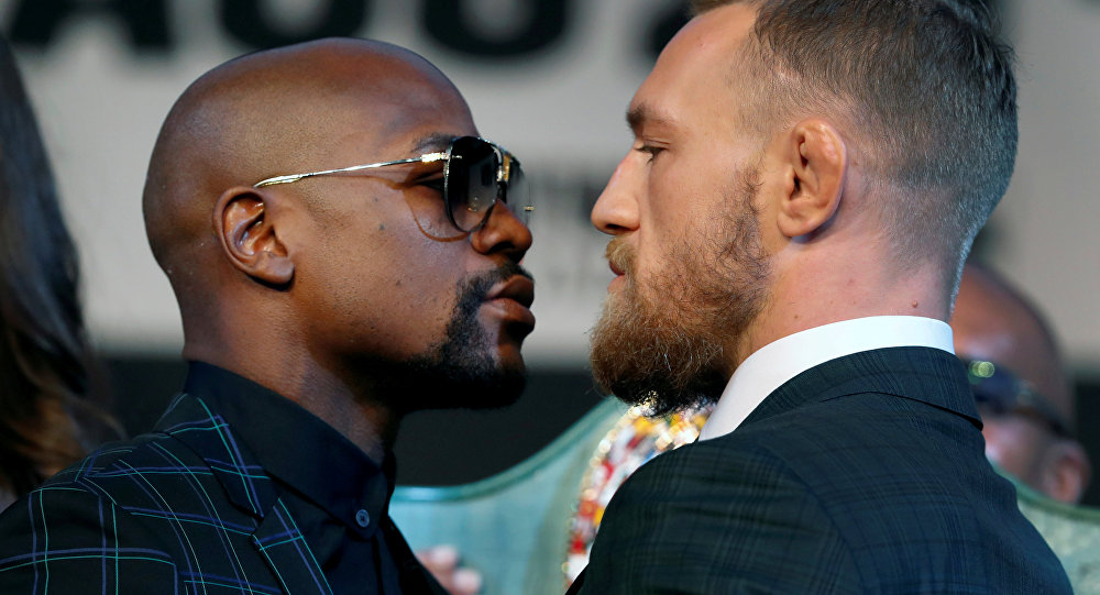Undefeated boxer Floyd Mayweather Jr. (L) of the U.S. and UFC lightweight champion Conor McGregor of IrelandConor McGregor of Ireland face off during a news conference in Las Vegas, Nevada, U.S. August 23, 2017.