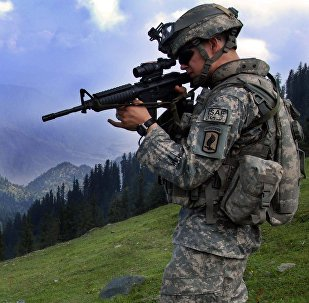 1st Lt. Chris Richelderfer, Executive Officer of Headquarters and Headquarters Troop, 1st Squadron, 91st Cavalry Regiment (Airborne), looks at possible enemy positions during Operation Saray Has July 19 near Forward Operating Base Naray, Afghanistan.