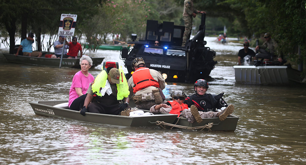A rescue boat evacuates people from the rising waters of Buffalo Bayou following Hurricane Harvey in a neighborhood west of Houston, Texas, U.S., August 30, 2017