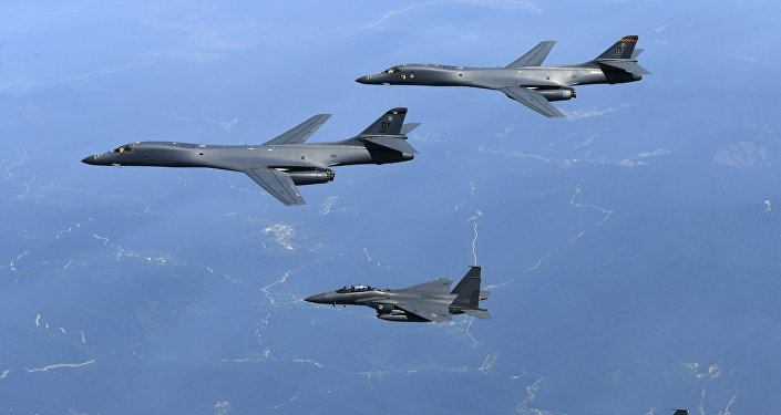 In this June 20, 2017 file photo provided by South Korean Defense Ministry, U.S. Air Force B-1B bombers, top, and second from top, and South Korean fighter jets F-15K fly over the Korean Peninsula, South Korea