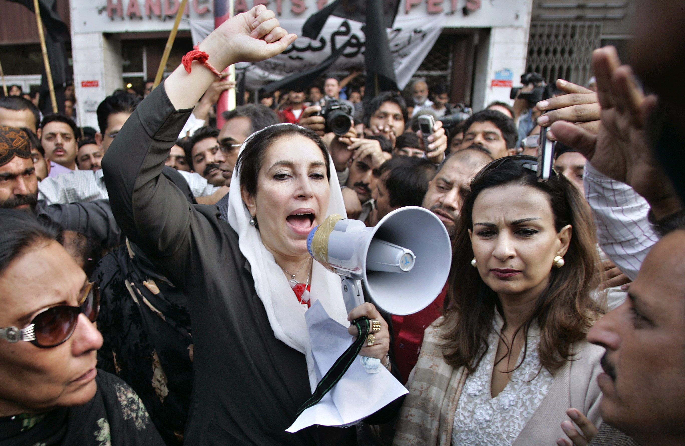 Pakistan's former Prime Minister Benazir Bhutto, center, shouts freedom freedom slogans at a protest camp arranged by journalists against the media crackdown, Saturday, Nov. 10, 2007 in Islamabad, Pakistan.