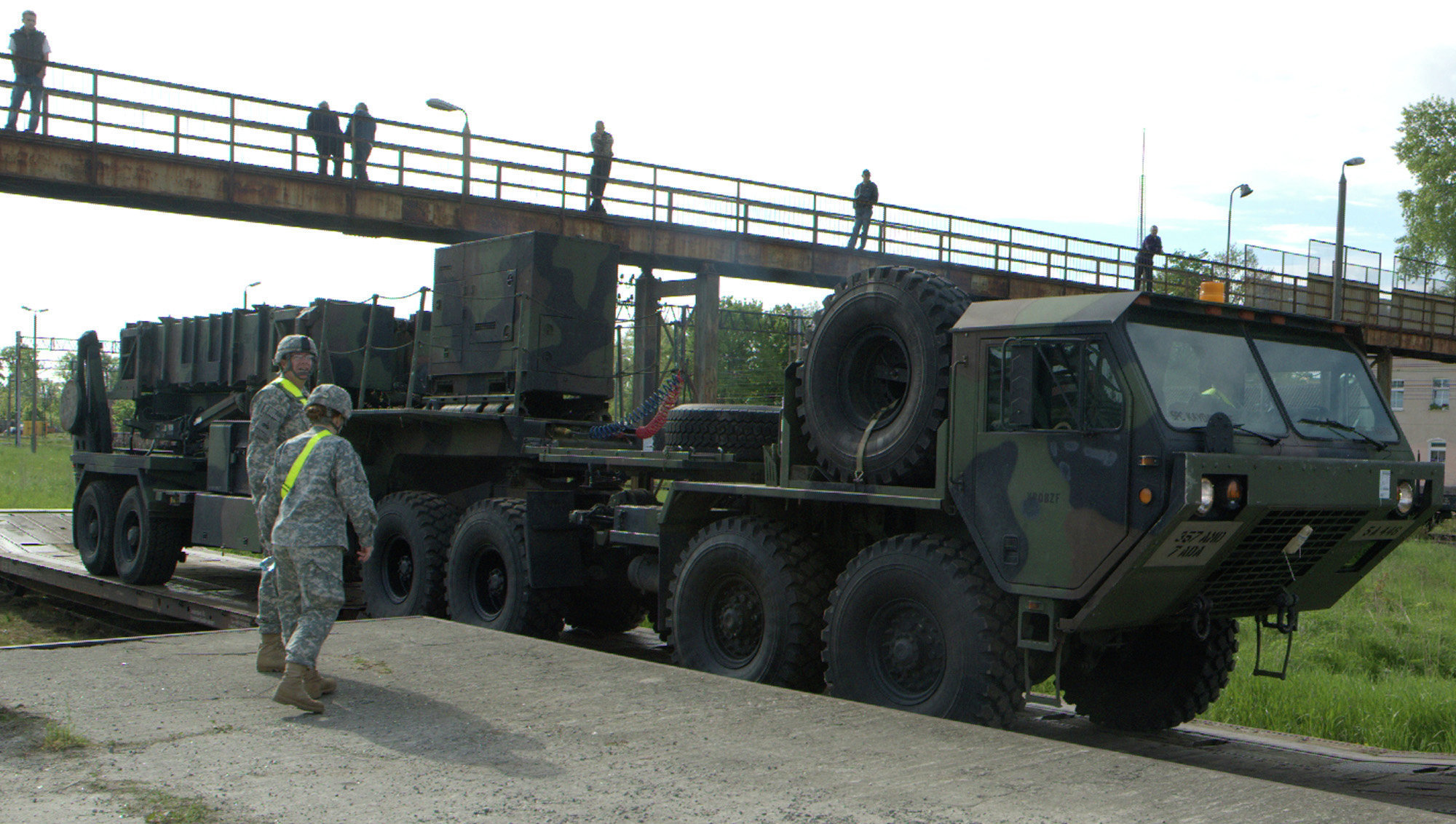 Soldiers watch a US Patriot missile being unloaded in a Polish Army military unit in Morag, northern Poland. File photo.