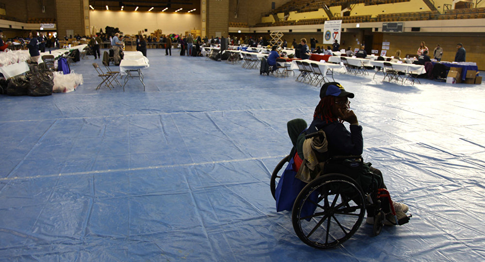 A female veteran sits in a wheelchair as veterans from all eras gathered Thursday, Nov. 10, 2011, at the Humboldt Park Armory in Chicago for an event sponsored by the Veteran's Administratration on the eve of Veteran's Day