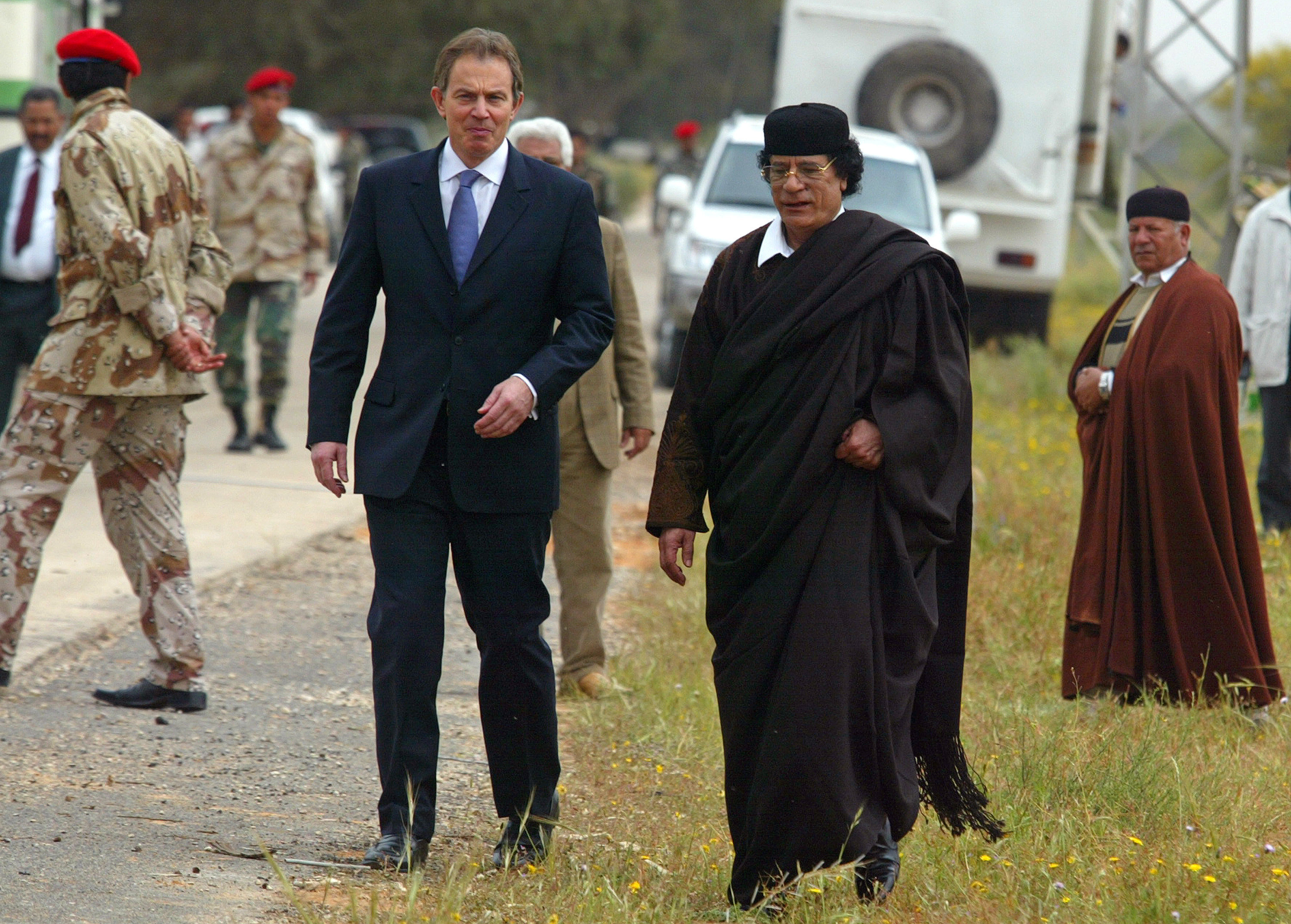Libyan leader Col. Moammar Gadhafi, at right, with Britain's Prime Minister Tony Blair as they meet outside Tripoli, in Libya, Thursday, March, 25, 2004.