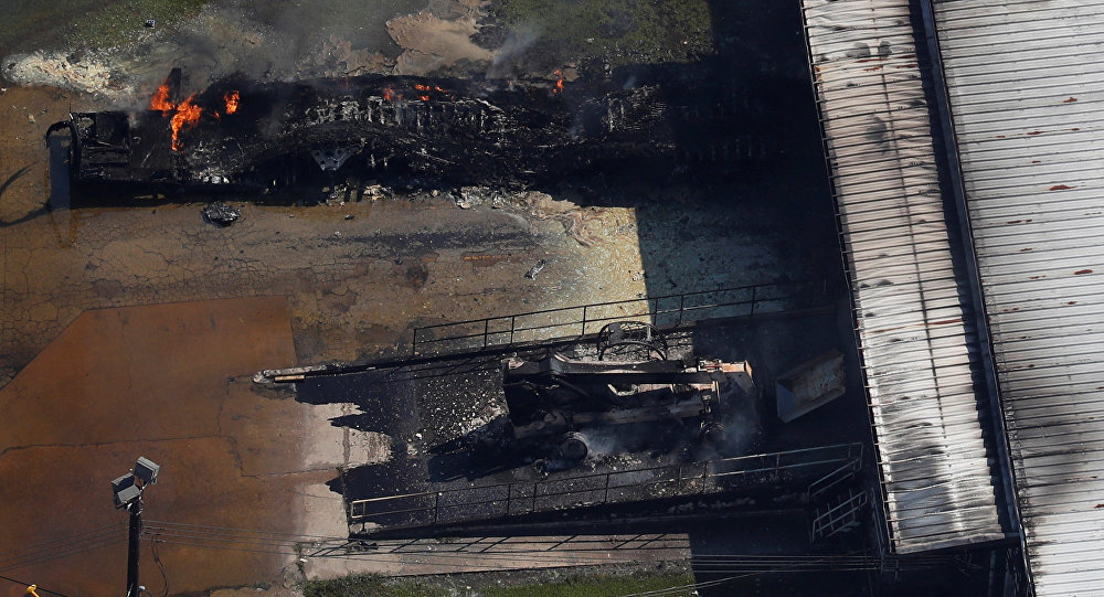 FILE PHOTO: A fire burns at the flooded plant of French chemical maker Arkema SA after Tropical Storm Harvey passed in Crosby, Texas, U.S. August 31, 2017.