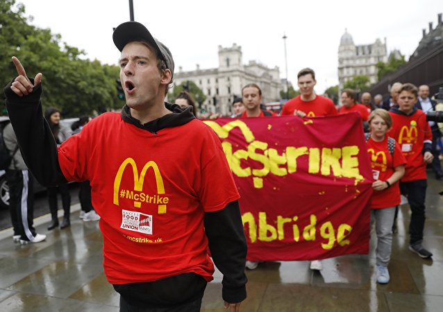 Demonstrators participate in a protest over working conditions and the use of zero-hour contracts at British outlets of US burger chain McDonalds, in central London