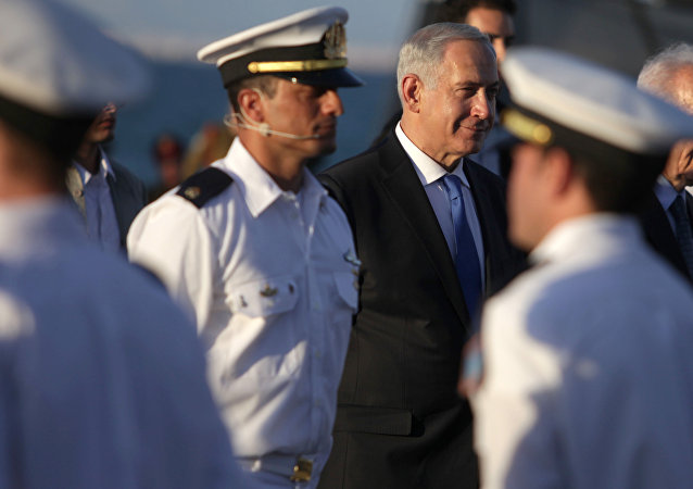 Israeli Prime Minister Benjamin Netanyahu, right, walks during a graduation ceremony of navy officers in the northern port city of Haifa, Israel, Wednesday, Sept., 11, 2013.
