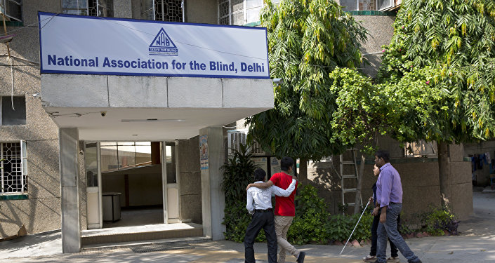 Visually impaired children walk in the National Association for the Blind premise in New Delhi, India, Tuesday, Sept. 5, 2017