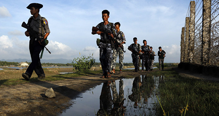 Myanmar police officers patrol along the border fence between Myanmar and Bangladesh in Maungdaw, Rakhine State, Myanmar. (File)