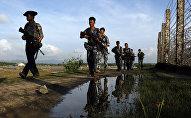 Myanmar police officers patrol along the border fence between Myanmar and Bangladesh in Maungdaw, Rakhine State, Myanmar. (File)