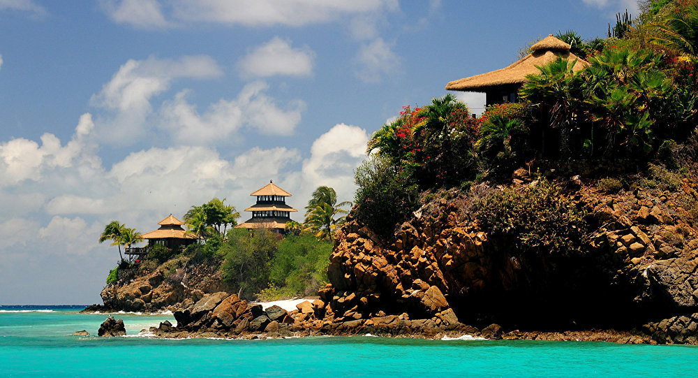 Buildings line the shore of Necker Island in the British Virgin Islands, Friday, May 17, 2013.