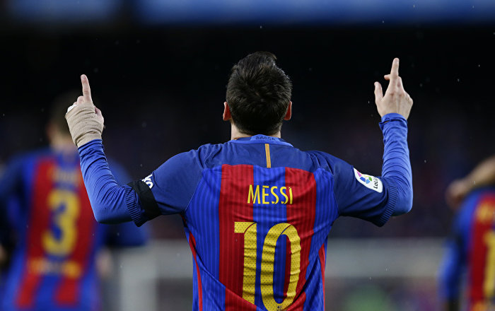FC Barcelona's Lionel Messi celebrates after scoring during the Spanish La Liga soccer match between FC Barcelona and Sevilla at the Camp Nou stadium in Barcelona, Spain, Wednesday, April 5, 2017