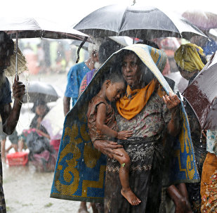 Rohingya refugees stands in an open place during heavy rain, as they are hold by Border Guard Bangladesh (BGB) after illegally crossing the border, in Teknaf, Bangladesh, August 31, 2017