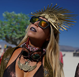 Pili Montilla wears a headdress as approximately 70,000 people from all over the world gathered for the annual Burning Man arts and music festival in the Black Rock Desert of Nevada, U.S. August 29, 2017