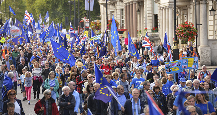 Demonstrators make their way along Piccadilly in London, Saturday Sept. 9, 2017, protesting Britain's plans to withdraw from the European Union