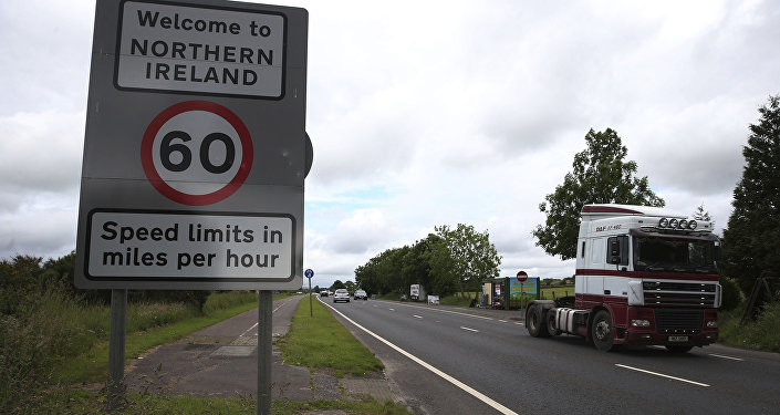 FILE - This is a June 15, 2016 file photo of of traffic crossing the border between the Republic of Ireland and Northern Ireland in the village of Bridgend, Co Donegal Ireland