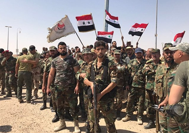 Troops of the Syrian 5th Army Corps join Syrian army units in the south of Deir ez-Zor following the breaking of the ISIL blockade at the main entrance to the city in the south