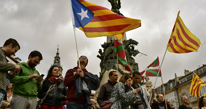 Spain threatens to nab Catalan separatist mayors