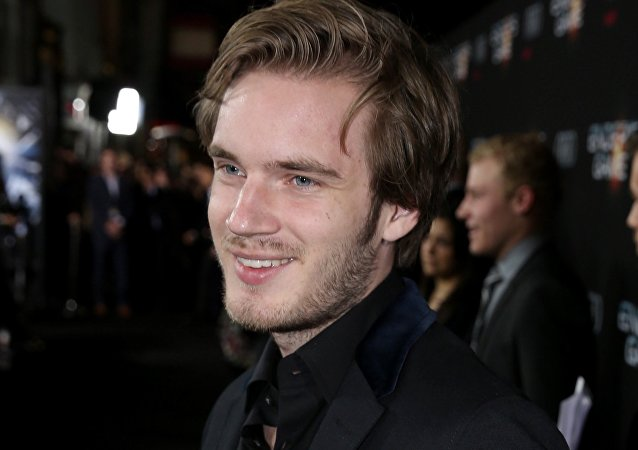 In this Oct. 28, 2013 file photo, Felix PewDiePie Kjellberg's arrives at the Los Angeles premiere of Ender's Game at TCL Chinese Theatre in Los Angeles.