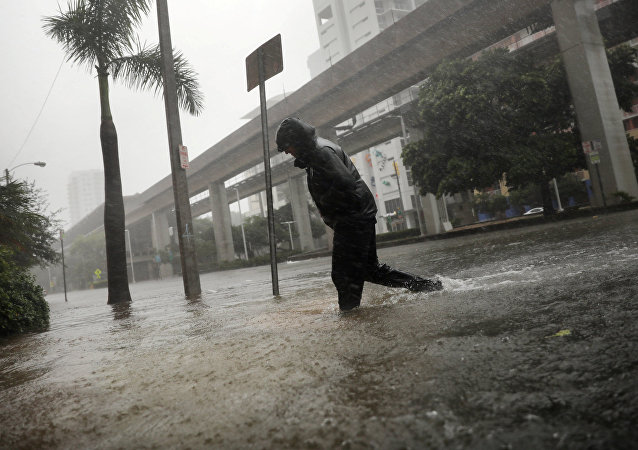 A local resident walks across a flooded street in downtown Miami as Hurricane Irma arrives at south Florida, U.S. September 10, 2017