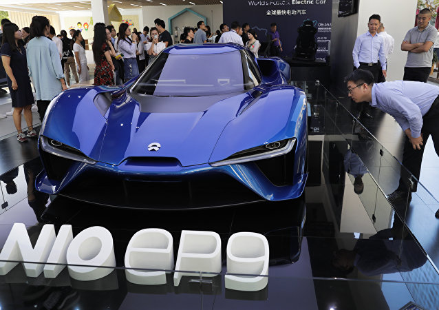 Visitor look at the Nio EP9, an electric-powered two-seated supercar manufactured by NIO during a promotion event at a shopping mall in Beijing