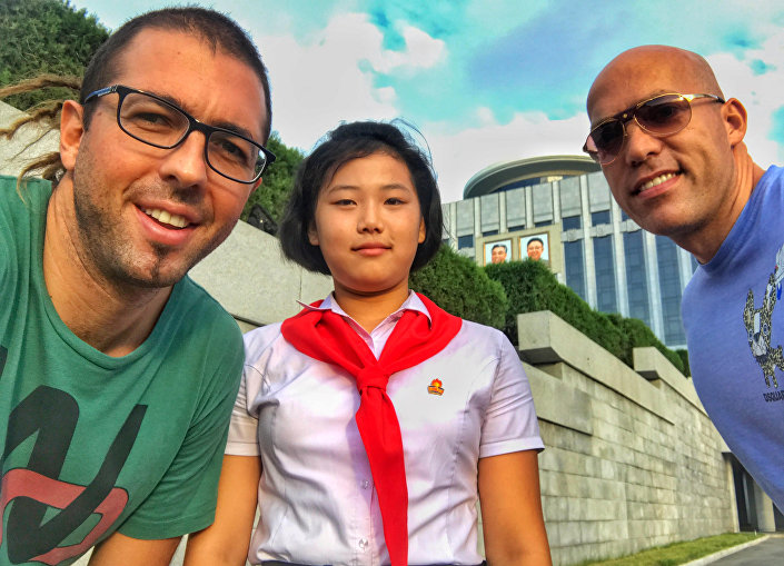 Philip Milosavljevic and his friend poses with N Korean schoolgirl