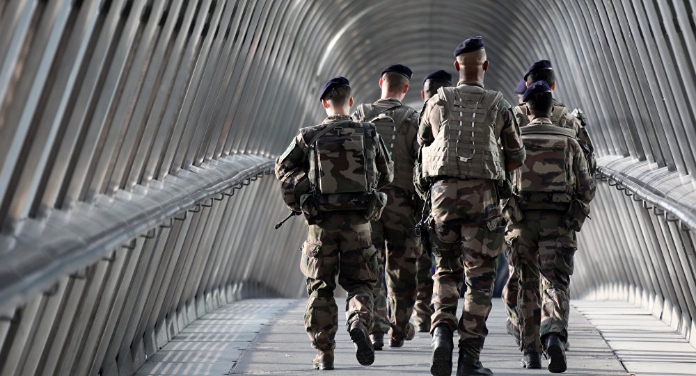 French troops of the Sentinel Operation patrol at the La Defense business district just outside of Paris on August 31, 2017