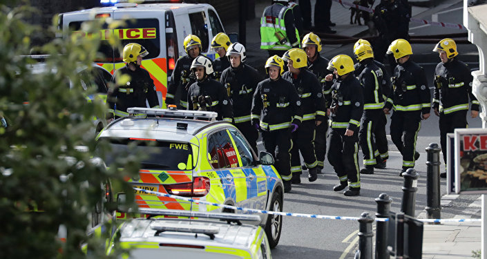 Members of the emergency services work near Parsons Green tube station in London, Britain September 15, 2017