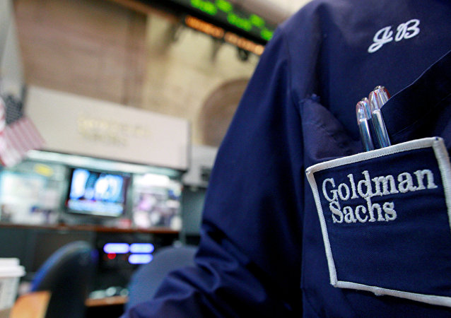 A trader works at the Goldman Sachs stall on the floor of the New York Stock Exchange, New York, U.S. (File)