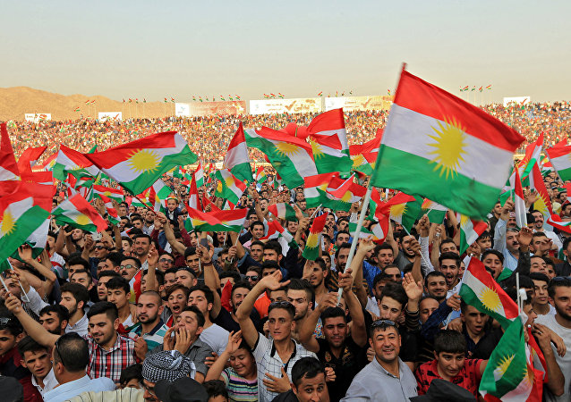 Kurdish people attend a rally to show their support for the upcoming September 25th independence referendum in Duhuk, Iraq September 16, 2017