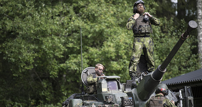 Swedish soldiers man a tank from Skaraborg's Swedish regiments practicing with a US-enhanced armored gun company as part of the preparations for Aurora 17 field exercise