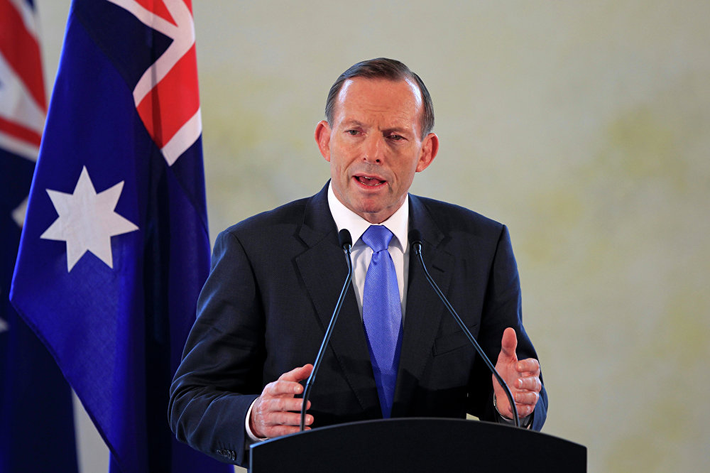 Former Australian Prime Minister Tony Abbott speaks during a joint press conference