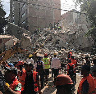 People clear rubble after an earthquake hit Mexico City, Mexico September 19, 2017