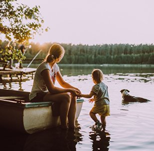 Woman, child, dog and sunset