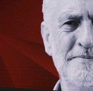Labour leader Jeremy Corbyn, gestures. during a general election broadcast, in London, Monday May 29, 2017. Prime Minister Theresa May and Labour Party leader Jeremy Corbyn will face a live studio audience and a tough TV interviewer as the general election campaign moves to the airwaves.