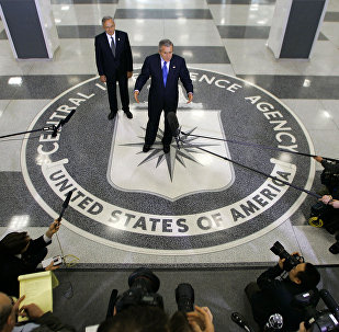 Former president Bush talks to reporters after he received an intelligence briefing at CIA Headquarters in Langley, Va., near Washington, Thursday, March 3, 2005. He is joined by Director of Central Intelligence Porter Goss.