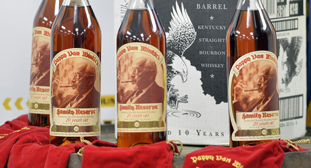 Recovered bottles of 20 year-old Pappy Van Winkle bourbon and Eagle Rare single barrel bourbon are shown during a news conference at the Franklin County Sheriff's Office, Tuesday, April 21, 2015, in Frankfort, Ky.