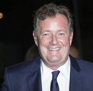 Piers Morgan poses for photographers upon arrival at the GQ magazine Awards at the Tate Modern in London, Tuesday, Sept. 6, 2016.