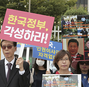 North Korean defectors stage a rally against South Korean government's policy against the North in front of the Government Complex in Seoul, South Korea, Friday, Sept. 22, 2017