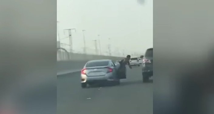 Road rage passenger hangs out of moving car and 'tries to punch' 4X4 driver - before getting instant