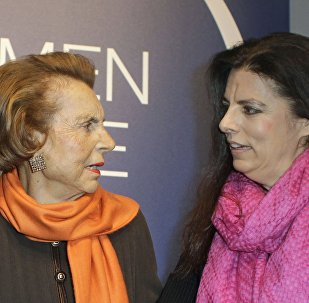 L'Oreal heiress Liliane Bettencourt, left, and her daughter Francoise Bettencourt Meyers, right, arrive to the L'Oreal-UNESCO prize for the women in science, in Paris, Thursday March 3, 2011.