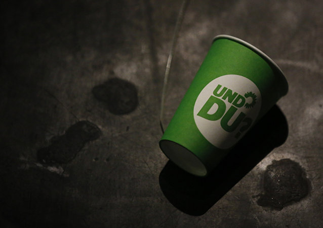A paper cup with the election campaign logo of the German Green Party that reads And you , lies on the ground after a party leader's press conference in Berlin, Germany, on September 23, 2013, a day after the German general elections.